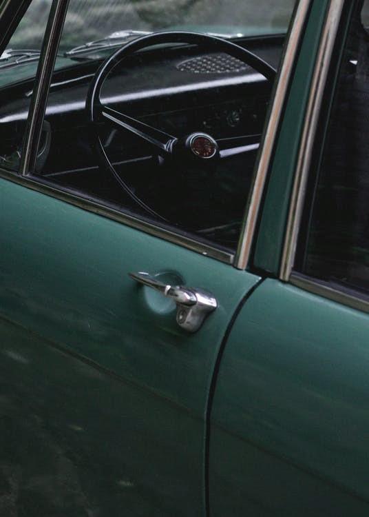 Vintage vehicle parked on a property.