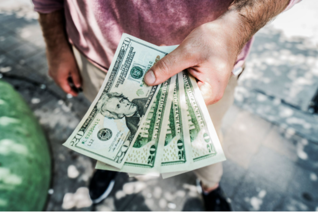 dollars in a man's hand