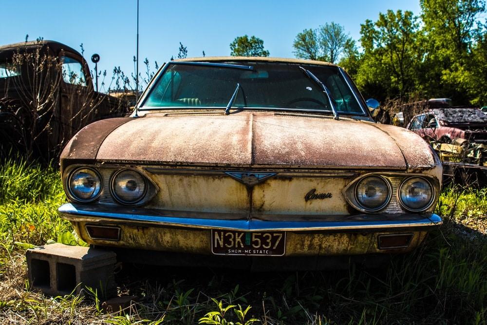 A rusted classic scrap car