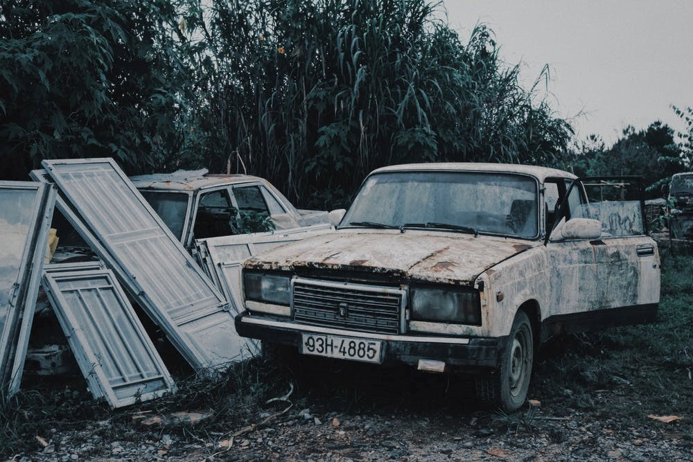A shabby damaged car that can be easily recycled.